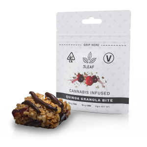 3Leaf Vegan Quinoa Granola Bite. One bite placed in front of the 3Leaf package.